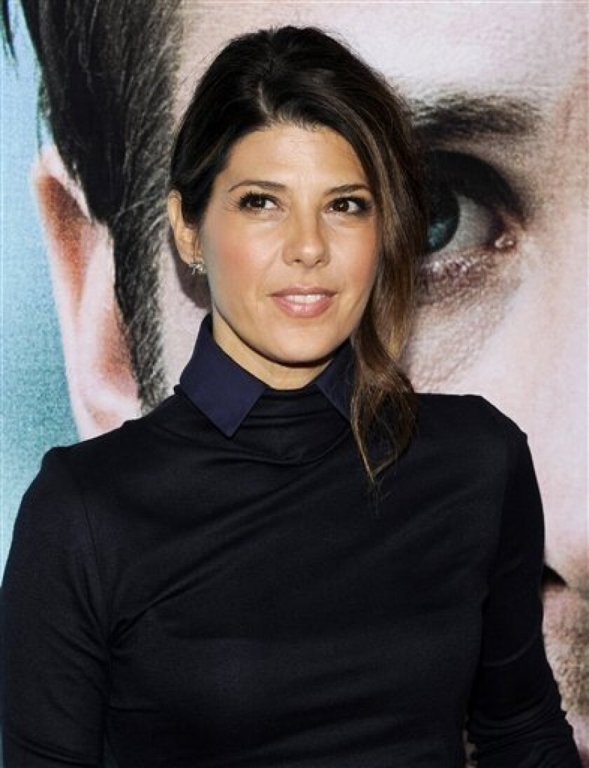 """FILE - In this Wednesday, Oct. 5, 2011 file photo, actress Marisa Tomei attends the premiere of """"Ides of March"""" at the Ziegfeld Theatre in New York. A lawsuit claims a leak from Marisa Tomei's New York City apartment has damaged the homes of two downstairs neighbors, including director John Waters, Thursday, Feb. 2, 2012. (AP Photo/Evan Agostini, File)"""