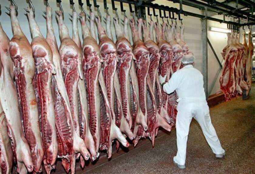 FILE - The Nov. 25, 2005 file photo shows sides of pork in a butchery in Meckenheim near Bonn, western Germany. A German state agricultural minister said Tuesday, Jan 12, 2011 hundreds of pigs must be killed on a farm in Lower Saxony because their meat contains high levels of dioxin. (AP Photo/Hermann J. Knippertz)