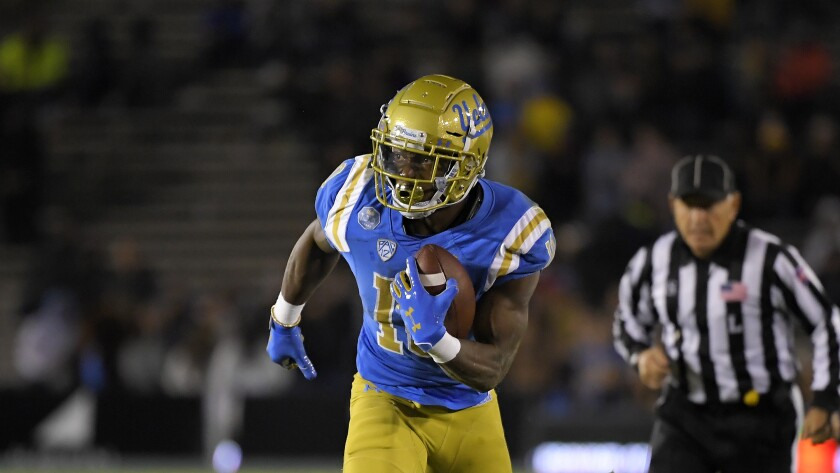 UCLA running back Demetric Felton Jr. runs the ball against California.