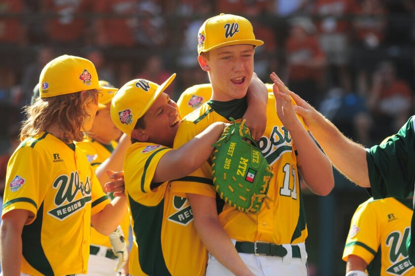Giancarlo Cortez, center, hugs Chula Vista pitcher Grant Holman after the West team from the Eastlake Little League won game 6 of the 2013 Little League World Series in South Williamsport.