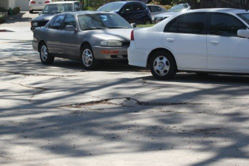 Proceed with caution when driving down Park Row, or your vehicle may need to be realigned. To check the status of this repair, phone the office of District 1 City Councilmember Sherri Lightner at (619) 236-6611.