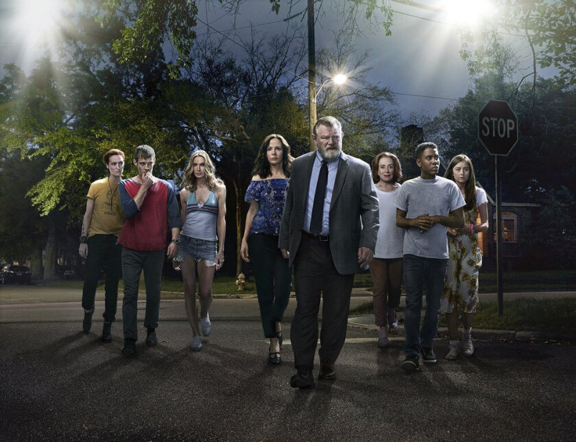 """This image released by Peacock shows, from left, Breeda Wool, Harry Treadaway, Kelly Lynch, Mary-Louise Parker, Brendan Gleeson, Holland Taylor, Jharrel Jerome and Justine Lupe from the series """"Mr. Mercedes,"""" based on a Stephen King trilogy. The first two seasons of """"Mr. Mercedes"""" will be bingeable on Peacock starting on Oct. 15. (Photo by: Sonar Entertainment/Peacock)"""