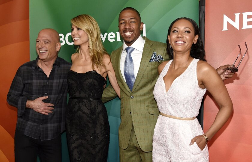 "FILE - In this April 2, 2015 file photo, Howie Mandel, from left, Heidi Klum, Nick Cannon and Melanie Brown from ""America's Got Talent,"" arrive at the NBC Universal Summer Press Day in Pasadena, Calif. The 10th season premieres Tuesday, May 26, at 8 p.m. ET. (Photo by Chris Pizzello/Invision/AP, Fi"