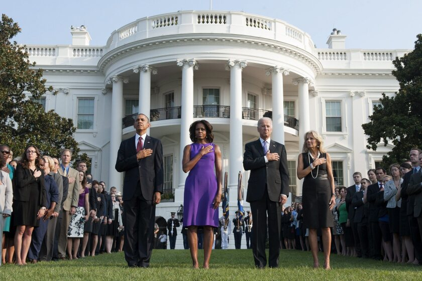President Obama, First Lady Michelle Obama, Vice President Joe Biden and Jill Biden observe a moment of silence at a ceremony marking the 12th anniversary of the 9/11 attacks in 2013.