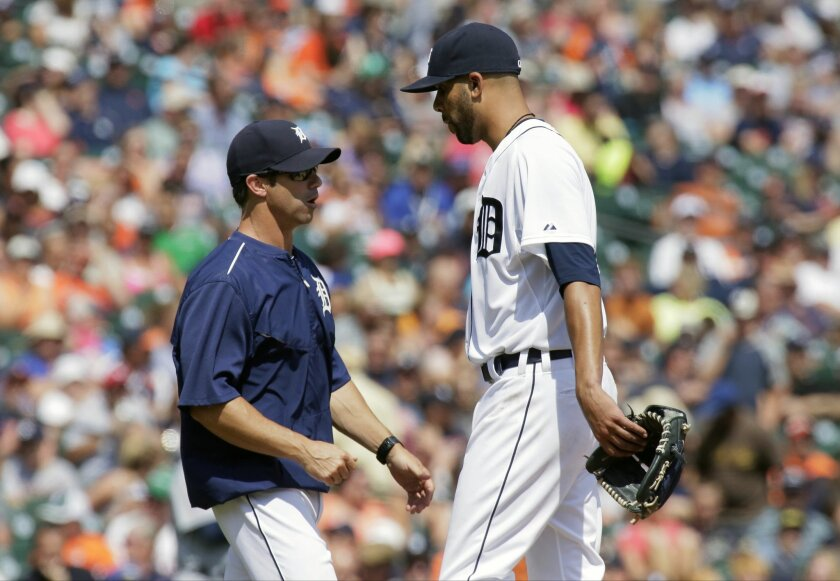 Detroit Tigers pitcher David Price, right, heads for the dugout after being pulled by manager Brad Ausmus during the eighth inning of a baseball game against the Seattle Mariners Thursday, July 23, 2015 in Detroit. The Mariners defeated the Tigers 3-2. (AP Photo/Duane Burleson)