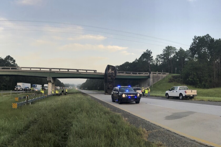 In this photo released by the Georgia Department of Transportation, the SR 86 bridge is inspected over Interstate 16 in Treutlen County, Ga., Thursday, July 15, 2021. The Interstate is shut down in both directions from Exit 71 to Exit 78 due to a large dump trailer hitting the SR 86 bridge and shifting it nearly six feet. (GDOT via AP)