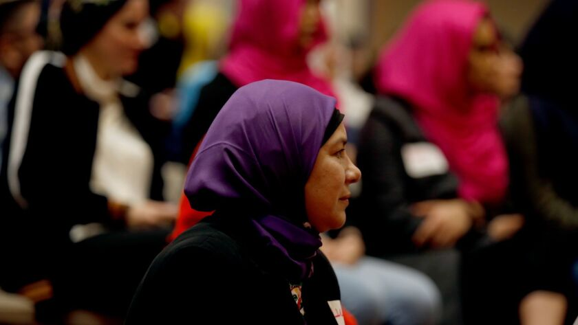 Lucy Silva participates in the #IStandWithHijabis event at the Islamic Society of Orange County in Garden Grove. (Francine Orr / Los Angeles Times)