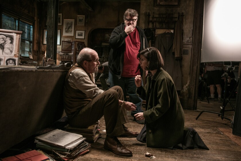 """(L-R) - Richard Jenkins, director Guillermo del Toro and Sally Hawkins on the set of """"THE SHAPE OF"""