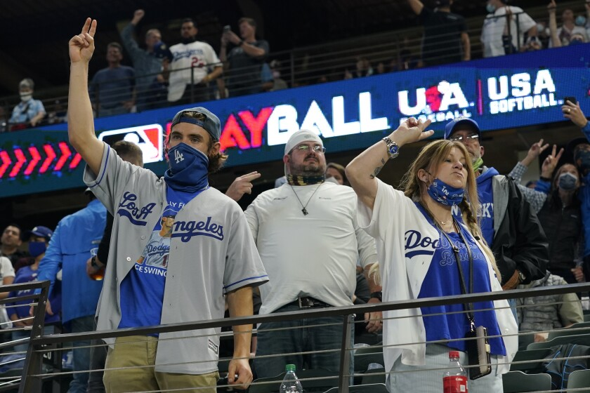 Los Angeles Dodgers fans cheer during the seventh inning in Game 5 of the baseball World Series against the Tampa Bay Rays Sunday, Oct. 25, 2020, in Arlington, Texas. (AP Photo/Eric Gay)