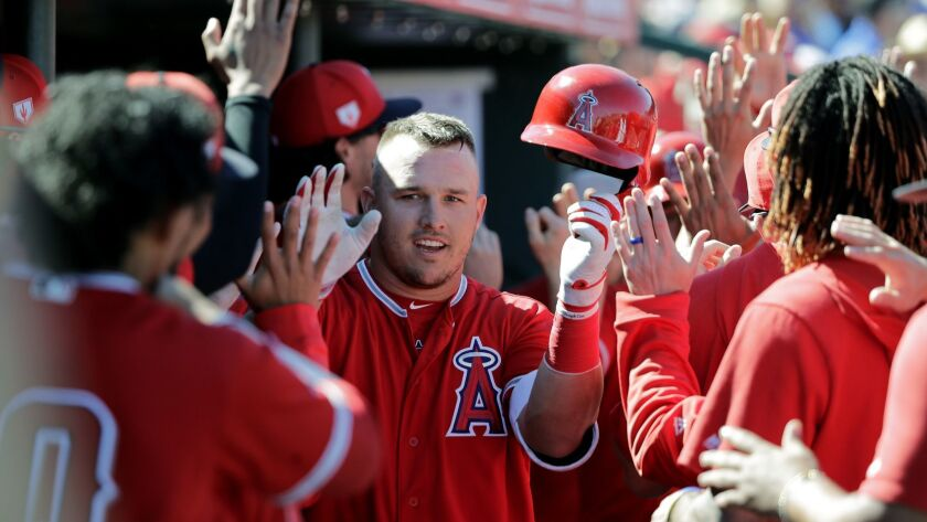 Angels' Mike Trout, center, is congratulated on his three-run home run against the Chicago Cubs in the third inning of a spring training game on Tuesday in Tempe, Ariz.