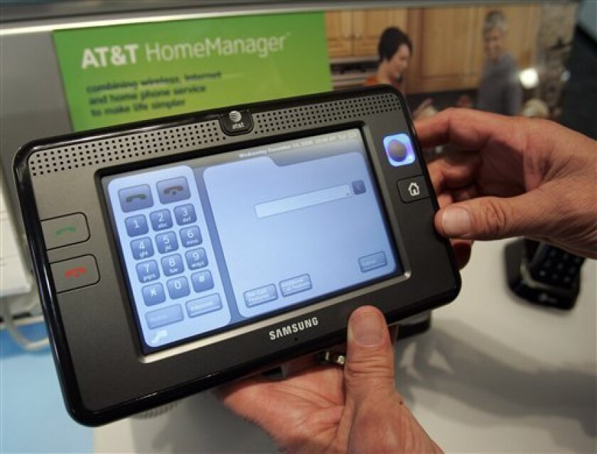 AT&T HomeManager on display at an AT&T store in San Bruno, Calif., Wednesday, Dec. 10, 2008. A home phone that puts the latest information at your fingertips is an old sci-fi staple, and now AT&T Inc. has a touch-screen gadget, called HomeManager, that brings the idea to fruition. (AP Photo/Paul Sakuma)