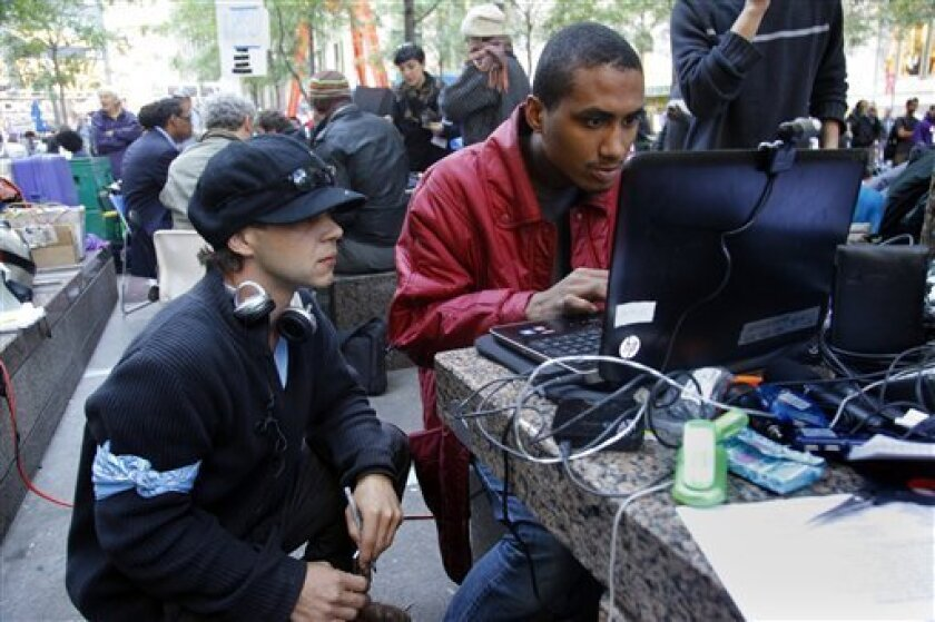 Thorin Caristo, left, a 37-year-old antique store owner from Plainfield, Conn., and Quacy Cayasso, a computer techie, setup and operate live streaming video from the site of the Occupy Wall Street Protest at Zuccotti Park on Thursday, Oct. 6, 2011 in New York. (AP Photo/Bebeto Matthews)
