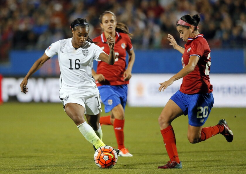 U.S. forward Crystal Dunn (16) controls the ball as Costa Rica midfielder Wendy Acosta (20) defends during the first half of a CONCACAF Olympic qualifying match on Feb. 10.