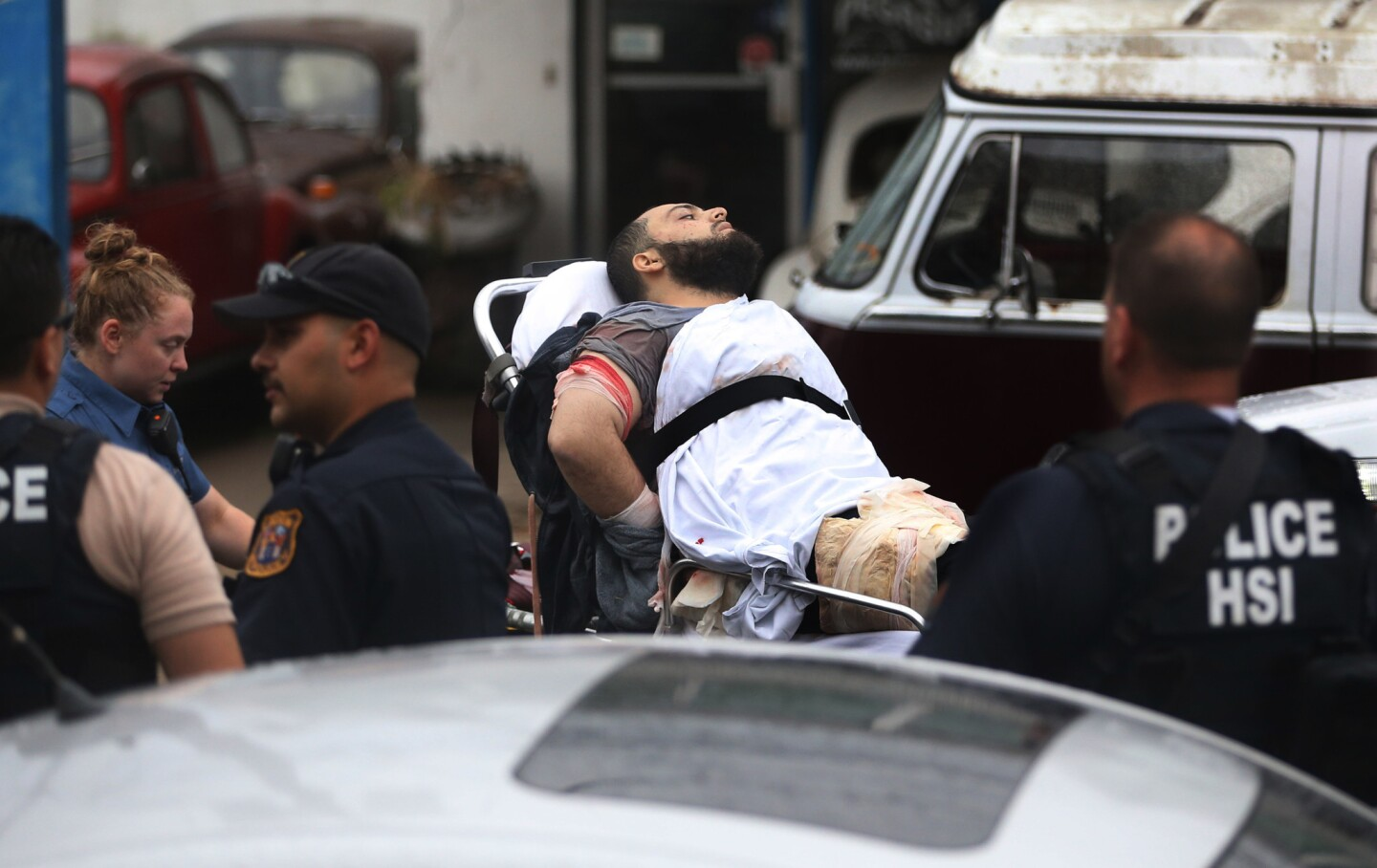 Ahmad Khan Rahami is transferred to an ambulance after being taken into custody following a Sept. 19 shootout with police in Linden, N.J.