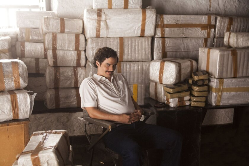 "This undated production photo provided by Netflix, shows actor Wagner Moura as Pablo Escobar, in the Netflix Original Series ""Narcos."" The biopic promises to be an authentic portrayal of Escobar, so it's only natural that Brazilian director and executive producer Jose Padilha chose to film the 10-episode series in Medellin, the murder capital of the world during the drug kingpin's heyday in the 1980s. (Daniel Daza/Netflix via AP)"