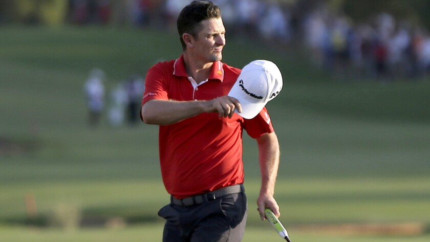 Justin Rose acknowledges the crowd after saving par at No. 18 during the third round of the DP World Tour Championship on Saturday.