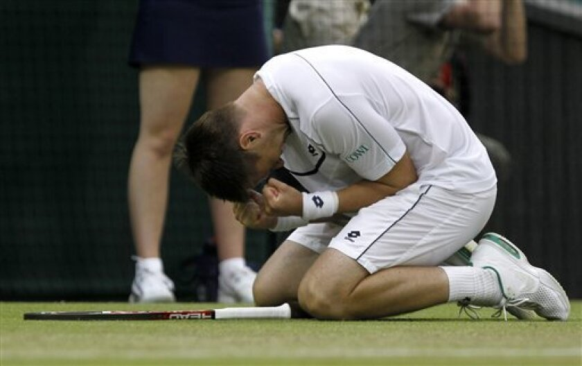 Sweden's Robin Soderling reacts after defeating Australia's Lleyton Hewitt at the All England Lawn Tennis Championships at Wimbledon, Thursday, June 23, 2011. (AP Photo/Anja Niedringhaus)