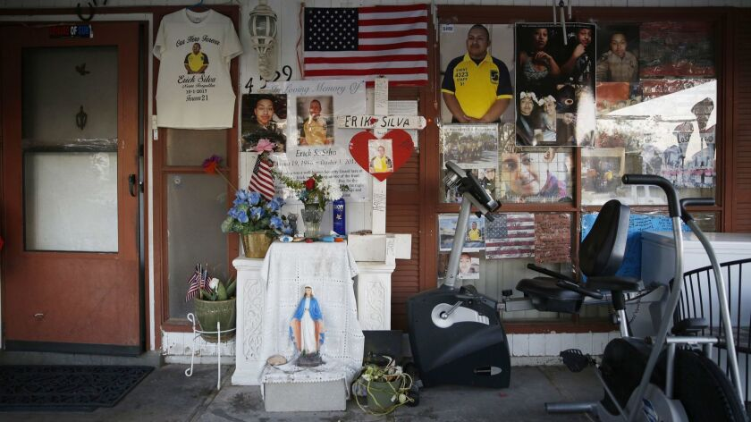 In this Sept. 19, 2018, photo, a makeshift memorial to Erick Silva is on display in front of his par