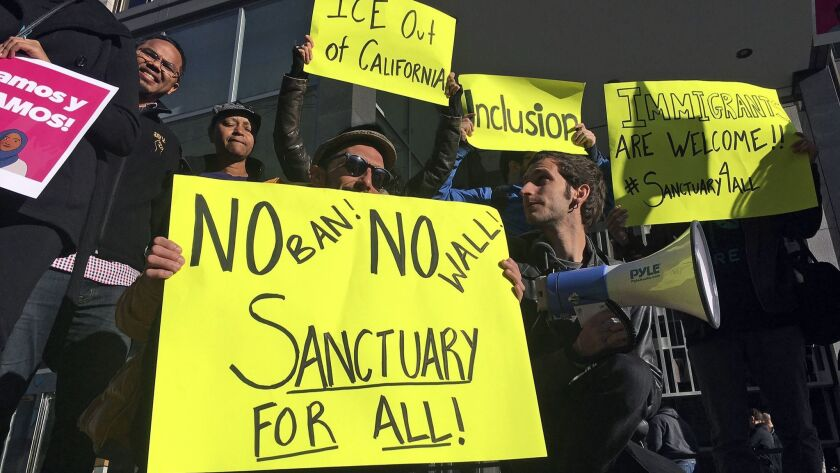 """Protesters outside the federal courthouse in San Francisco in 2017, when a judge blocked the Trump administration from withholding funds from """"sanctuary"""" cities. An appeals court on Wednesday ruled against the administration in the case."""