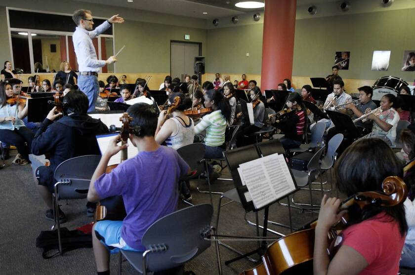 Bruce Kiesling conducts Youth Orchestra Los Angeles at the Expo center in Exposition Park in Los Angeles on Sept. 18, 2013.