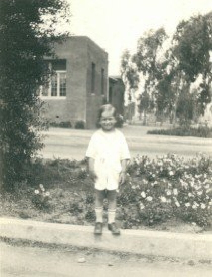 Eddo Spurr stands in front of the Ranch's first school. Courtesy Spurr Family