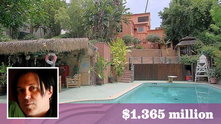 Queens of the Stone Age guitarist Troy Van Leeuwen lands in Glendale with home purchase.