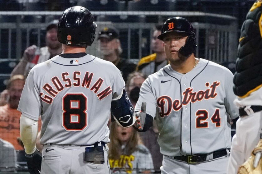 Detroit Tigers' Robbie Grossman (8) is greeted by Miguel Cabrera (24) after hitting a solo home run off Pittsburgh Pirates relief pitcher Cody Ponce during the seventh inning of a baseball game Wednesday, Sept. 8, 2021, in Pittsburgh. (AP Photo/Keith Srakocic)