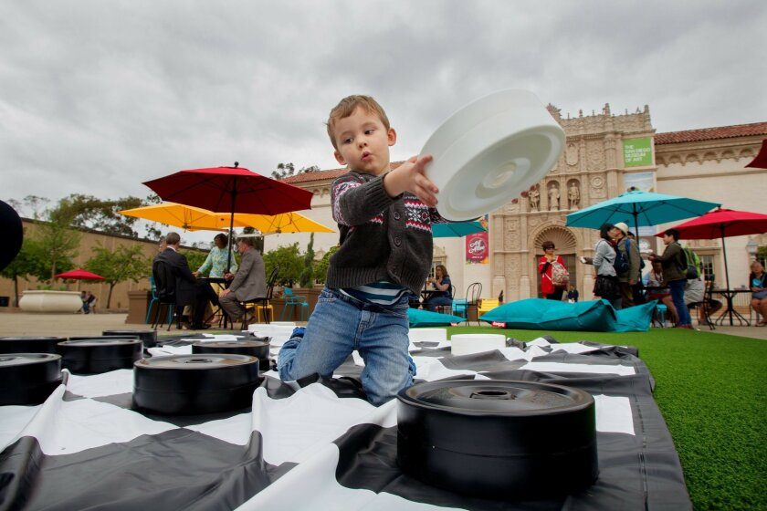 Dylan Anderson, 3, who is visiting with his parents from Texas, enjoys the new checkers set in the Balboa Park Plaza de Panama on Wednesday in San Diego, California. The new amenities were made possible by an $85K grant from Southwest Airlines.
