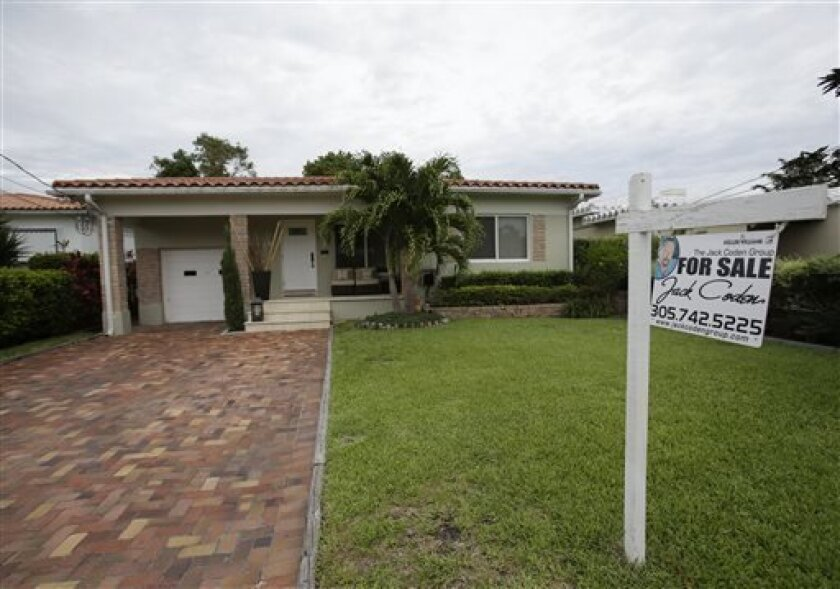 In this Tuesday, May 28, 2013 photo, a single family home is shown for sale in Surfside, Fla. U.S. home prices jumped 12.2 percent in May from a year ago, the most in seven years. The increase suggests the housing recovery is strengthening. Real estate data provider CoreLogic said Tuesday, July 2, 2013, that home prices rose from a year ago in 48 states. They fell only in Delaware and Alabama. And all but three of the 100 largest cities reported price gains. (AP Photo/Wilfredo Lee)