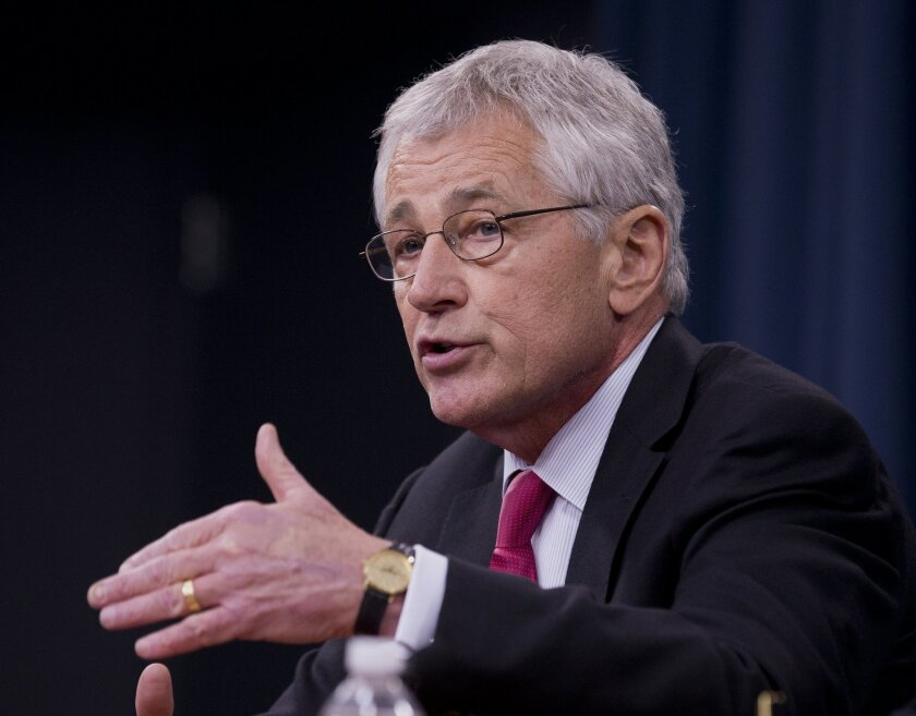 Defense Secretary Chuck Hagel speaks during a news conference at the Pentagon, Wednesday, Dec. 4, 2013. Hagel said cutting his Pentagon staff by 20 percent will save at least $1 billion over five years. (AP Photo/Manuel Balce Ceneta)