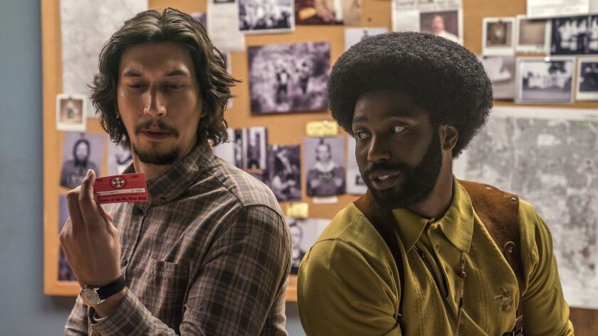 This image released by Focus Features shows Adam Driver, left, and John David Washington in a scene