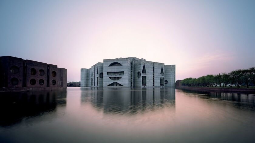 The National Assembly Building in Dhaka, Bangladesh, was begun in 1962 and completed in 1982.