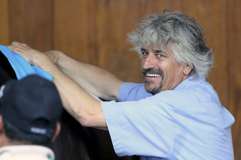 FILE - In this May 1, 2019, file photo, trainer Steve Asmussen smiles at Churchill Downs in Louisville, Ky. Hall of Famer Steve Asmussen became the all-time leading trainer at Churchill Downs on Friday, June 12, 2020, saddling Drop Dead Gorgeous to a win in the first race for his 738th victory beneath the Twin Spires. (AP Photo/Gregory Payan, File)
