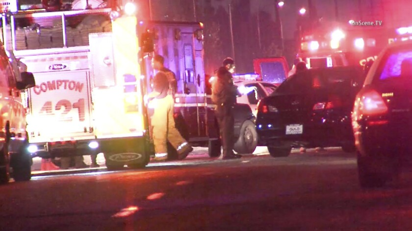 Los Angeles County Sheriff's deputies and the Compton Fire Department respond to a shooting early Sunday morning in Compton.