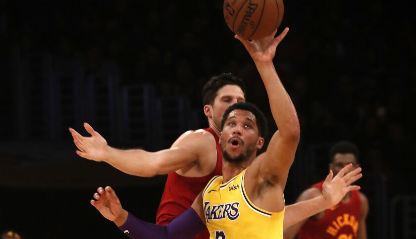 LOS ANGELES, CALIF. - NOV. 29, 2018. Lakers guard Josh Hart steals the ball from Pacers forward Do