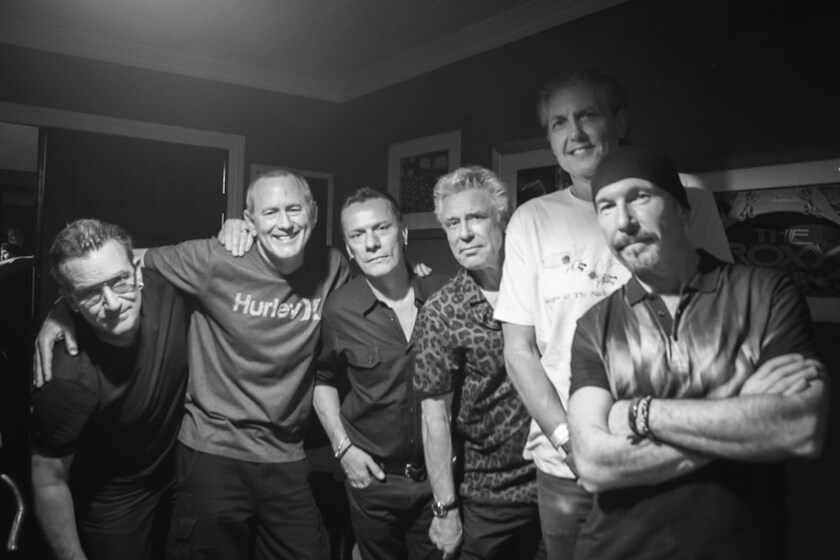 """Kevin and Bean with U2: from left, Bono, Kevin Ryder, Larry Mullen Jr., Adam Clayton, Gene """"Bean"""" Baxter and the Edge."""