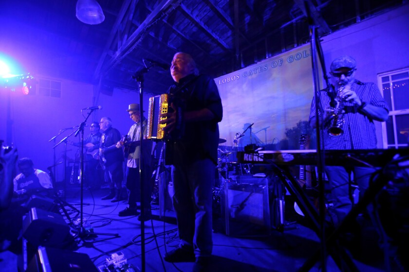 """Los Lobos performs an intimate concert for family and friends to celebrate the band's new album, """"Gates of Gold,"""" at El Gallo Plaza in East Los Angeles on Sept. 29, 2015."""