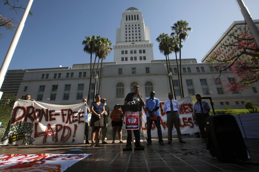 Activists seeking to limit the use of drones by law enforcement protested on the south steps of City Hall.