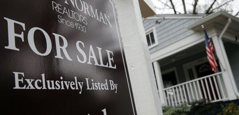 """In this Tuesday, Jan. 26, 2016, photo, a """"For Sale"""" sign hangs in front of an existing home in Atlanta. On Thursday, Feb. 25, 2016, Freddie Mac reports on the week's average U.S. mortgage rates. (AP Photo/John Bazemore)"""