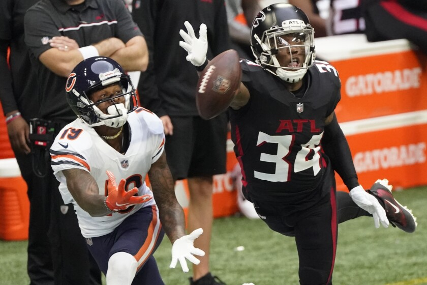 Atlanta Falcons defensive back Darqueze Dennard (34) misses the catch against Chicago Bears wide receiver Ted Ginn (19) during the first half of an NFL football game, Sunday, Sept. 27, 2020, in Atlanta. (AP Photo/John Bazemore)