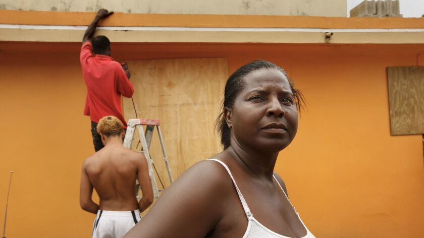 Monica Pisarro, age 49, outside her home in Loiza.