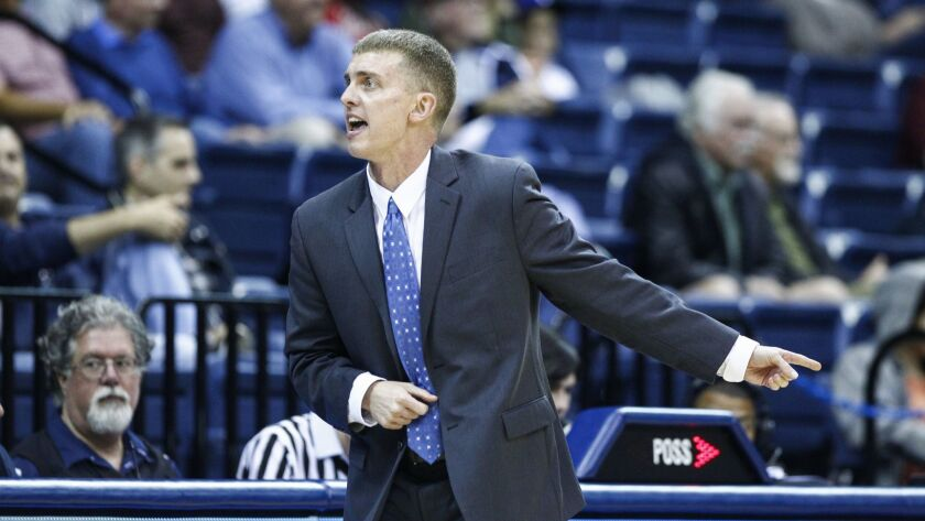 USD acting head coach Sam Scholl motions to his bench during the second half against Hartford.