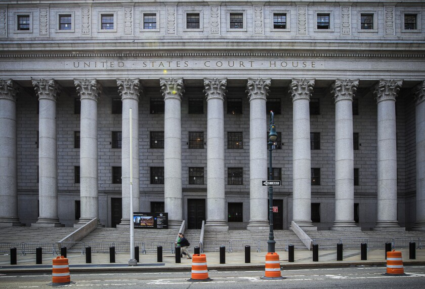 FILE - This photo from Tuesday May 3, 2011, shows the Thurgood Marshall U.S. Courthouse where the Second Circuit Court of Appeals is located in New York's lower Manhattan. The federal appeals court Wednesday, Jan. 8, 2020, rejected a motion from the Trump administration that would have allowed it to implement a policy connecting the use of public benefits with whether immigrants could become permanent residents. (AP Photo/Mary Altaffer, File)