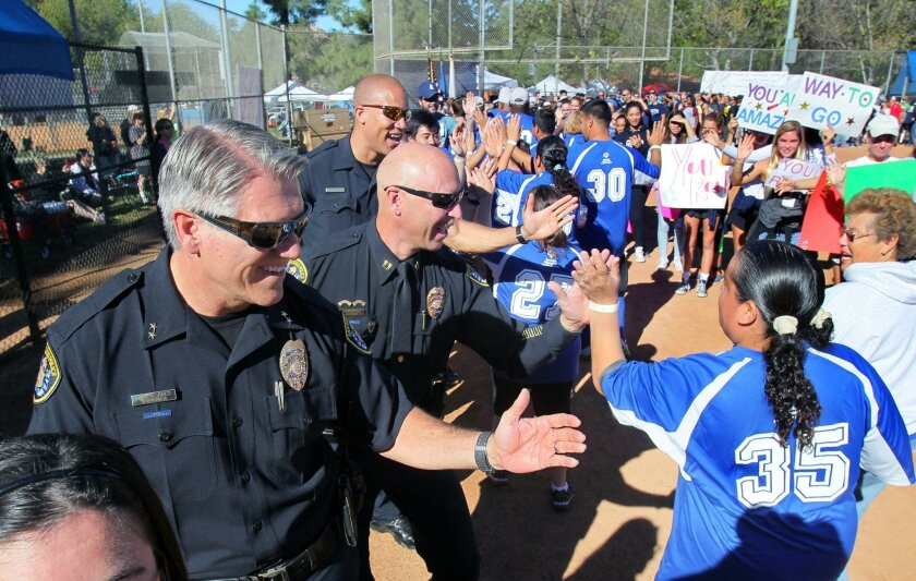 Assistant Police Chief Mark Jones (left) and other officers support Special Olympics qualifiers in Rancho Bernardo this month.