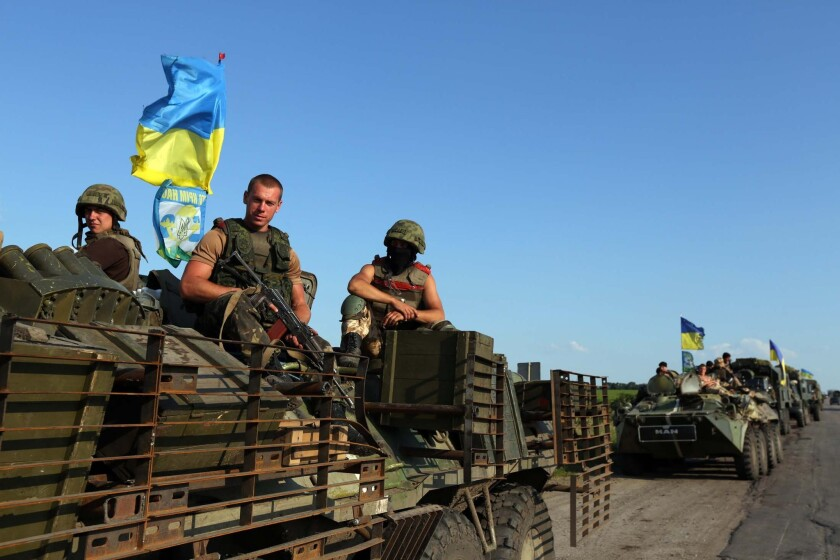 Ukrainian servicemen on patrol Friday near the eastern Ukrainian city of Slovyansk, which government troops liberated from separatist rebels last weekend.