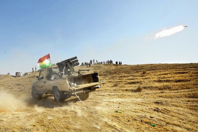 Kurdish forces fire missiles during clashes with militants of the Islamic State of Iraq and Syria in Jalawla, in Iraq's Diyala province, on June 14.