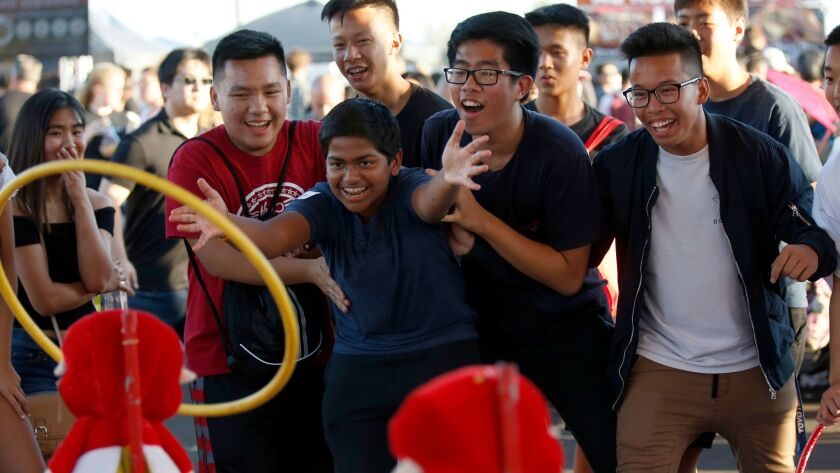 Roshan Kannan, 15, of Arcadia is surrounded by friends at the 626 Night Market this week.