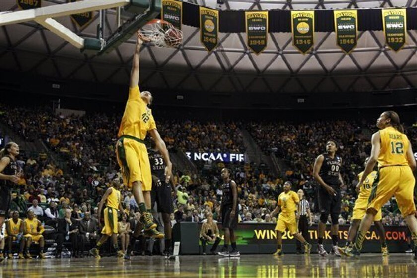 Baylor's Brittney Griner (42) dunks as Jordan Madden (3), Niya Johnson (2), Destiny Williams (10) and Alexis Prince (12) watch with Florida State's Natasha Howard (33) and Chasity Clayton (00) during the second half of a second-round game in the women's NCAA college basketball tournament, Tuesday,