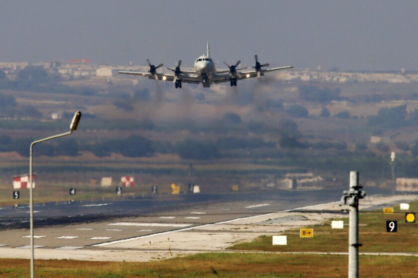 "A United States Navy aeroplane about to land at the Incirlik Air Base, in the outskirts of the city of Adana, southern Turkey, Wednesday, July 29, 2015. Turkish Foreign Ministry spokesman Tanju Bilgic said Wednesday, that an agreement allowing the U.S.-led coalition against the IS to launch airstrikes from Incirlik and other Turkish bases has been approved by Cabinet. Coalition forces could start using the bases ""any moment,"" Bilgic said. (AP Photo/Emrah Gurel)"