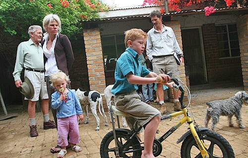 """Mike Campbell, left, with daughter Laura, her husband, Ben Freeth, and their two children in 2007. Campbell, who was born in South Africa, says his family's roots in the region date back to the early 18th century. """"We're not British or Scottish or anything,"""" he says. """"We're African."""""""